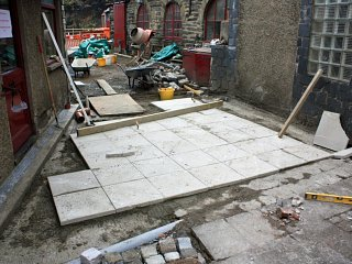 New concrete flooring outside the Den