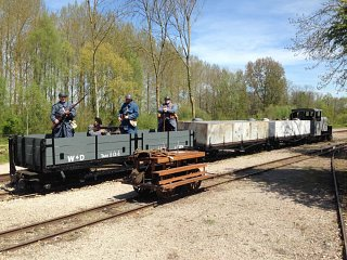 Volunteers man the train, with Busta in the foreground