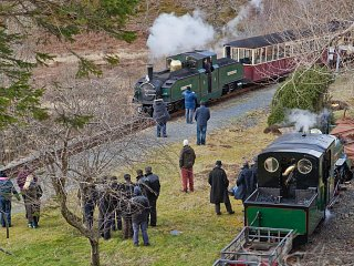 The Earl of Merioneth passes the slate train in the siding at Dduallt
